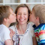portrait of Mum being kissed by her two sons at home in Geneva Geneve by Lifestyle photographer Gill Maheu Photography, photographe de famille