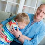 portrait of Dad tickling young son at home in Geneva Geneve by Lifestyle photographer Gill Maheu Photography, photographe de famille