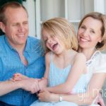 portrait of mum dad and daughter cuddling at home in Geneva Geneve by Lifestyle photographer Gill Maheu Photography, photographe de famille