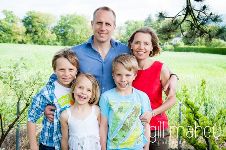 portrait of gorgeous family of five cuddling in Geneva Geneve by Lifestyle photographer Gill Maheu Photography, photographe de famille