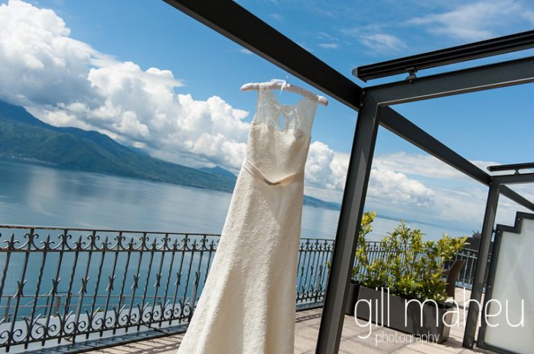 full length shot Augusta Jones wedding dress in front of fabulous view of Lake Geneva at the Hotel Baron le tavernier, Chexbres before Chateau de Glerolles wedding by Gill Maheu Photography, photographe de mariage