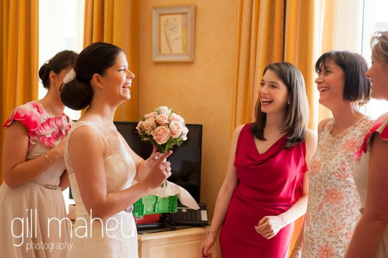 bride and sister during bridal preparations at the Hotel Baron le tavernier, Chexbres before Chateau de Glerolles wedding by Gill Maheu Photography, photographe de mariage