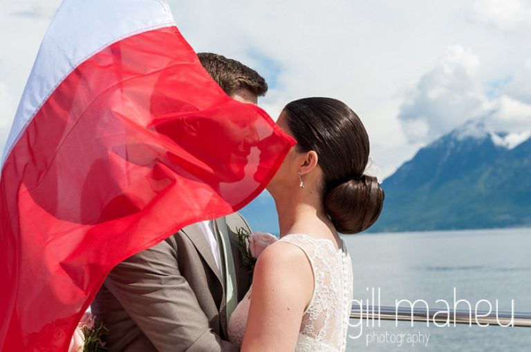 Portrait of bride and groom kissing on CGN bateau Belle Epoque on lake Geneva on way to Chateau de Glerolles wedding by Gill Maheu Photography, photographe de mariage