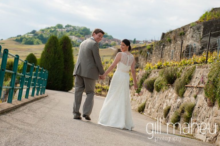 portrait of bride and groom in front of stunning view of Lac Leman in the vineyards above Chateau de Glerolles wedding by Gill Maheu Photography, photographe de mariage