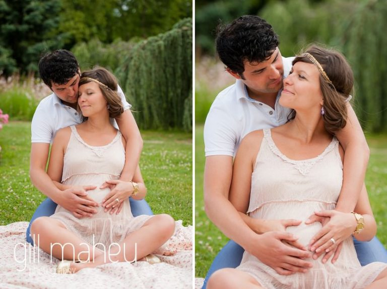 Future parents having a cuddle at romantic strawberry picnic in maternity session in Parc de la Tete D'or in Lyon, by Gill Maheu Photography, photographe de Grossesse et lifestyle