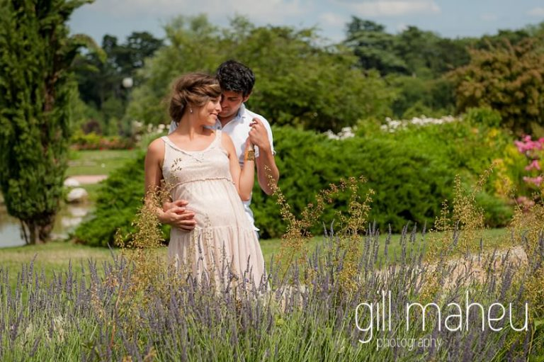 future parents in sunny lavendar filled portrait on maternity session in Parc de la Tete D'or in Lyon, by Gill Maheu Photography, photographe de Grossesse et lifestyle