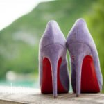 close up of stunning Christian Louboutin lavender coloured high heel shoes with red soles at Abbaye de Talloires, Annecy wedding by Gill Maheu Photography, photographe de mariage