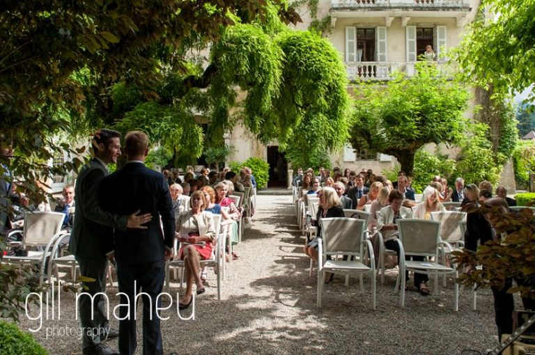 wide angle shot of the wedding ceremony in the gardens at Abbaye de Talloires, Annecy wedding by Gill Maheu Photography, photographe de mariage