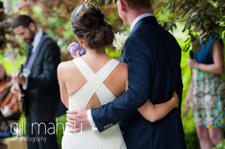 back shot of bride and groom with arms around each other at Abbaye de Talloires, Annecy wedding by Gill Maheu Photography, photographe de mariage