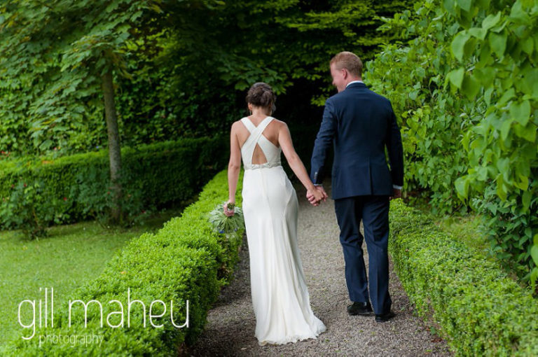 bride and groom walking away from the camera showing off the back of stunning Jenny Packham wedding dress at Abbaye de Talloires, Annecy wedding by Gill Maheu Photography, photographe de mariage
