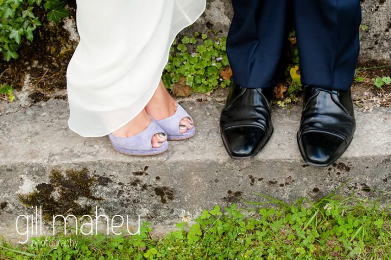 close up of wedding couples Louboutin shoes at Abbaye de Talloires, Annecy wedding by Gill Maheu Photography, photographe de mariage