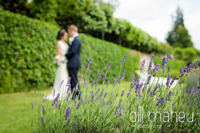bride and groom photographed through lavender having a quiet moment at Abbaye de Talloires, Annecy wedding by Gill Maheu Photography, photographe de mariage
