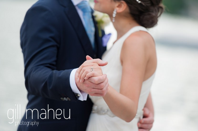 close up on hands of wedding couple dancing at Abbaye de Talloires, Annecy wedding by Gill Maheu Photography, photographe de mariage