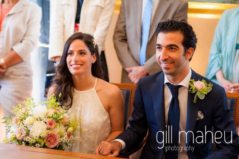 bride and groom holding hands during wedding ceremony at the Mairie de Versoix, Geneva before Baron le Tavernier Chexbres civil wedding by Gill Maheu Photography, photographe de mariage
