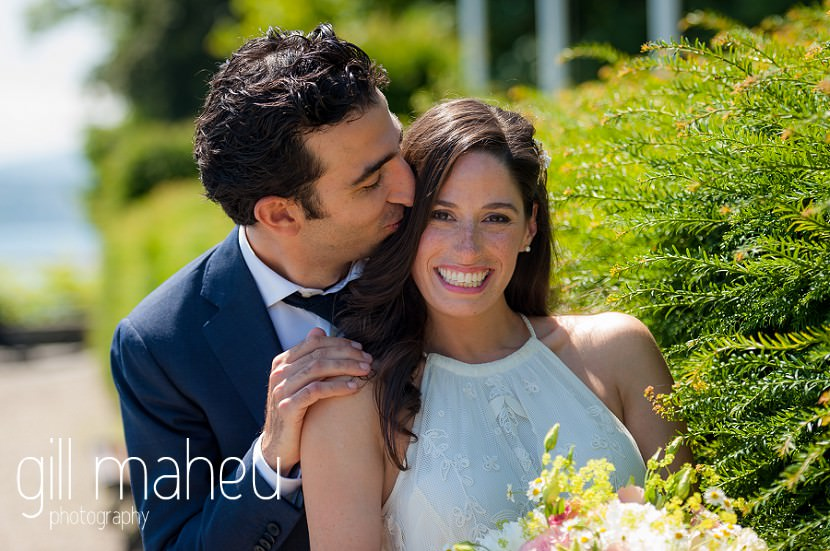 Romantic portrait of groom kissing brides cheek in the gardens of Mairie de Versoix at Baron le Tavernier Chexbres civil wedding by Gill Maheu Photography, photographe de mariage