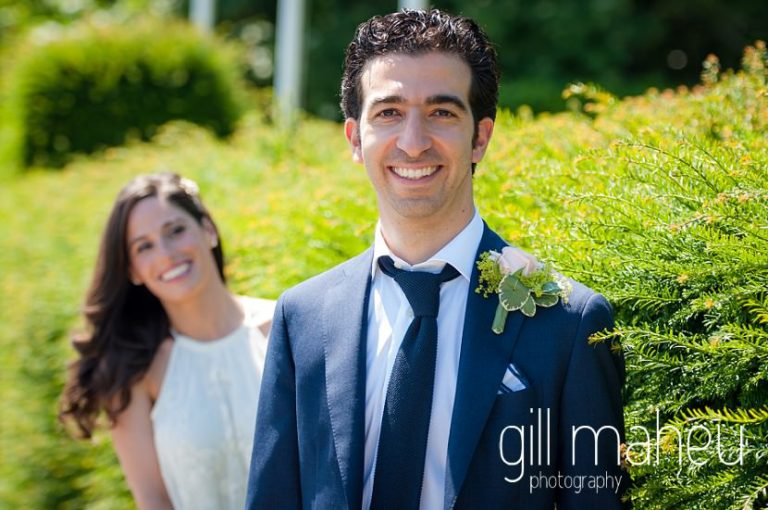 portraits of groom and bride in background in the gardens of the Mairie de Versoix, Geneva after their civil wedding ceremony by Gill Maheu Photography, photographe de mariage