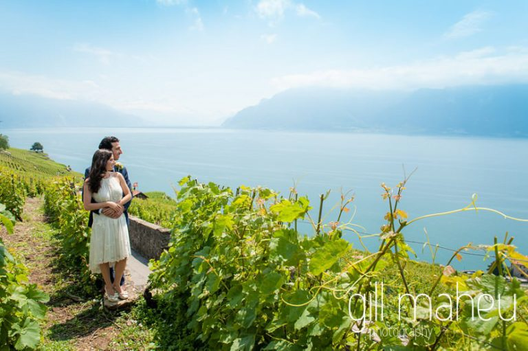 wide angle view of portrait of bride and groom in front of stunning view of Lake Geneva Baron le Tavernier Chexbres civil wedding by Gill Maheu Photography, photographe de mariage