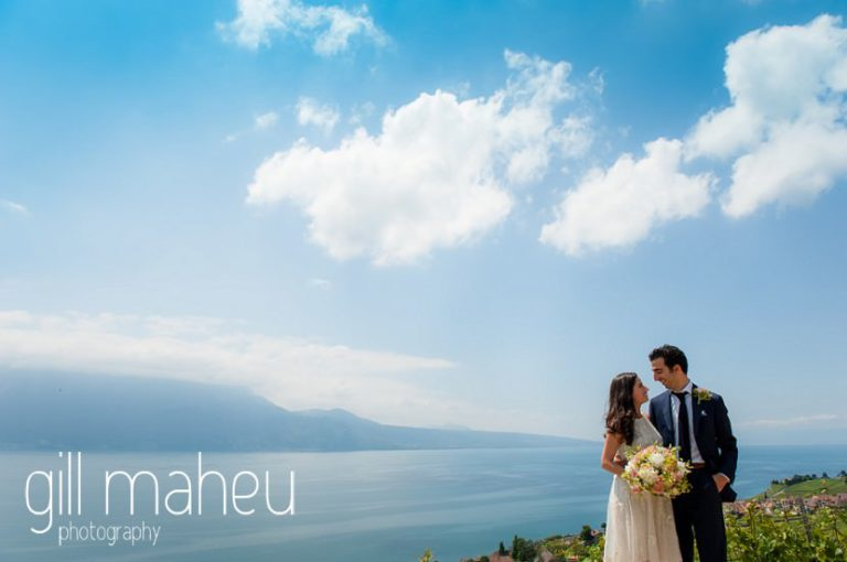 wide angle view portrait of bride and groom in front of stunning view of Lake Geneva Baron le Tavernier Chexbres civil wedding by Gill Maheu Photography, photographe de mariage