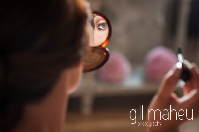 bride looking in mirror during bridal preparations at Hotel Imperial Palace, Annecy wedding by Gill Maheu Photography, photographe de mariage