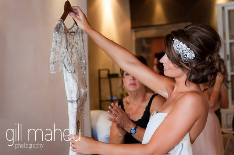 bride admiring her 1920 inspired beaded Jenny Packham wedding dress at Hotel Imperial Palace, Annecy wedding by Gill Maheu Photography, photographe de mariage