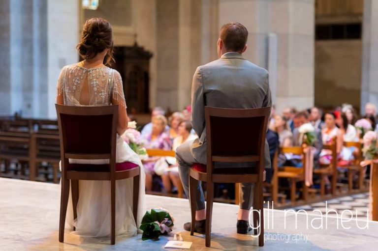 back view of bride and groom in wedding ceremony at Notre Dame de Liesse, Annecy wedding by Gill Maheu Photography, photographe de mariage