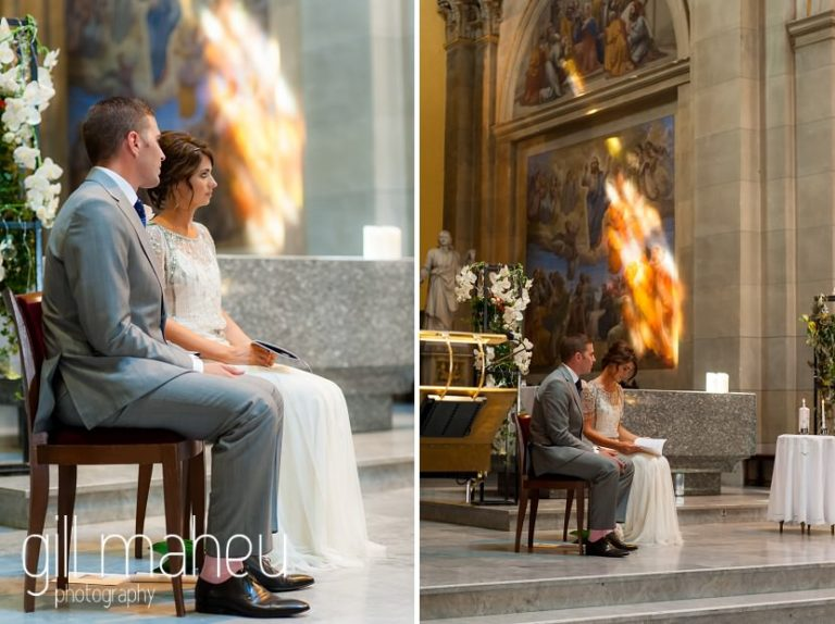 view of bride and groom in wedding ceremony at Notre Dame de Liesse, Annecy wedding by Gill Maheu Photography, photographe de mariage