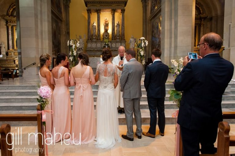 bride and groom and bridesmaids and groomsmen in wedding ceremony at Notre Dame de Liesse, Annecy wedding by Gill Maheu Photography, photographe de mariage