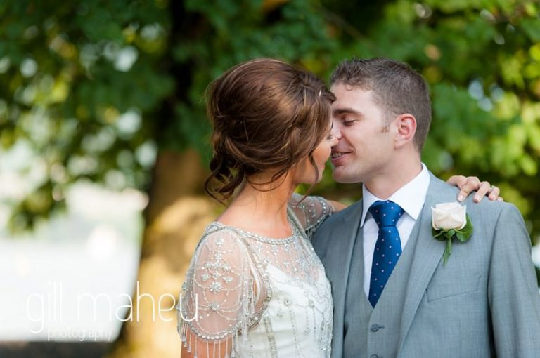 bride and groom kissing in the gardens of the Hotel Imperial Palace, Annecy wedding by Gill Maheu Photography, photographe de mariage