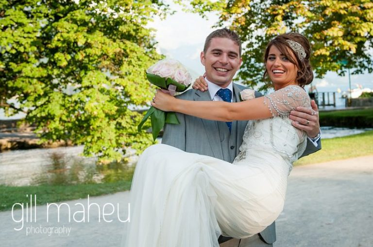 Bride in the arms of her gorgeous groom in the gardens of the Hotel Imperial Palace, Annecy wedding by Gill Maheu Photography, photographe de mariage