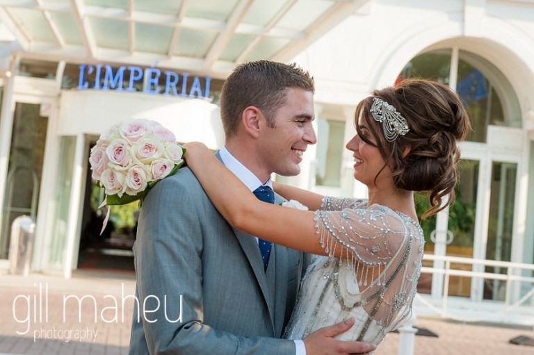 bride and groom dancing in front of Hotel Imperial Palace, Annecy wedding by Gill Maheu Photography, photographe de mariage