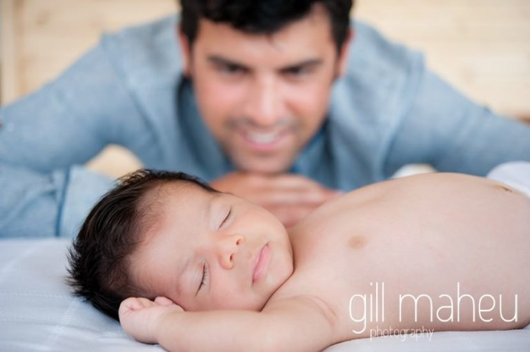 close up portrait of dad admiring new baby in new baby new family portrait session in Annecy by Gill Maheu Photography, photographe de bébé et famille
