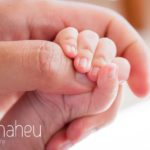close detail of tiny little new baby hand holding dad's finger in new baby in new baby new family portrait session in Annecy by Gill Maheu Photography, photographe de bébé et famille
