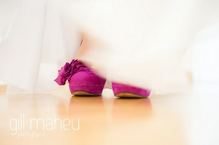 cerise pink marion wedding shoes peeking out from under whilte silk Max Chaoul wedding dress at Nantua, Jura wedding by Gill Maheu Photography, photographe de mariage