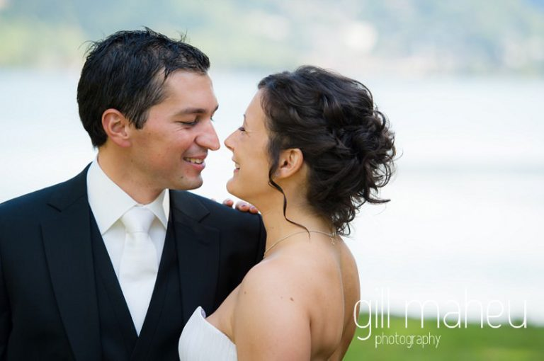 bride and groom at first look in front of stunning lake Nantua, Jura wedding by Gill Maheu Photography, photographe de mariage