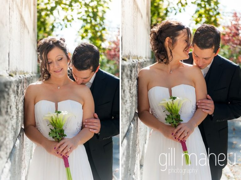 groom cuddling bride and kissing her shoulder at Nantua, Jura wedding by Gill Maheu Photography, photographe de mariage