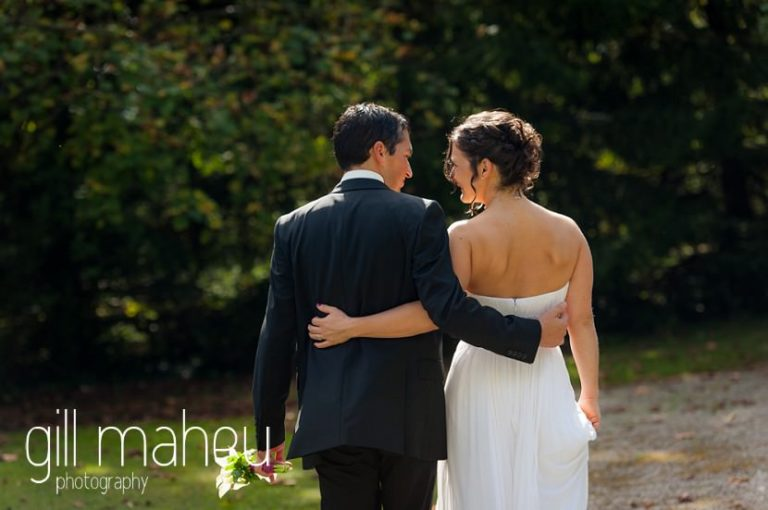 bride and groom walking away from the camera in the gardens at Nantua, Jura wedding by Gill Maheu Photography, photographe de mariage
