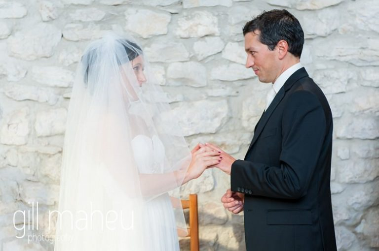 bride and groom exchanging wedding rings at Nantua, Jura wedding by Gill Maheu Photography, photographe de mariage