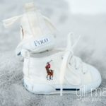 details of little Polo Ralph Lauren baby shoes at in new baby new family portrait session in Aix les Bains by Gill Maheu Photography, photographe de bébé et famille