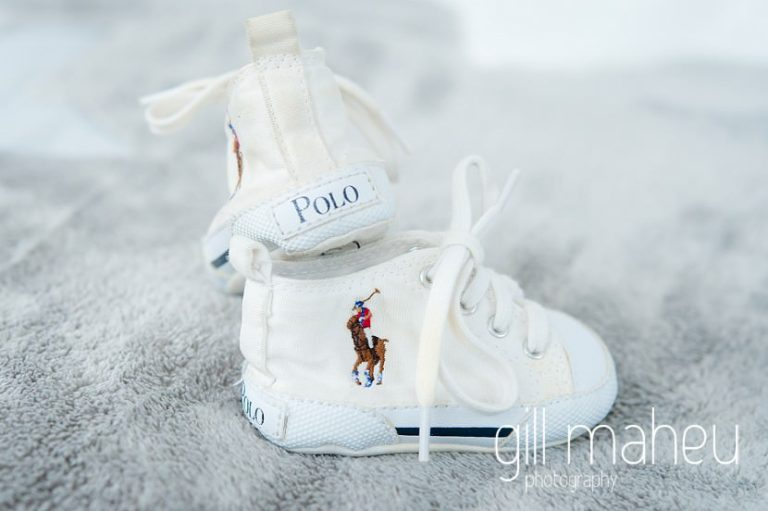 details of little Polo Ralph Lauren baby shoes at in new baby new family portrait session in Aix les Bains by Gill Maheu Photography, photographe de bébé et famille