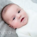 close up of adorable smiling baby in new baby new family portrait session in Aix les Bains by Gill Maheu Photography, photographe de bébé et famille