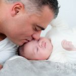 portrait of papa kissing new baby at new baby new family portrait session in Aix les Bains by Gill Maheu Photography, photographe de bébé et famille