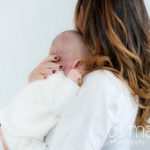 young baby snuggling ino mum's shoulder in at new baby new family portrait session in Aix les Bains by Gill Maheu Photography, photographe de bébé et famille