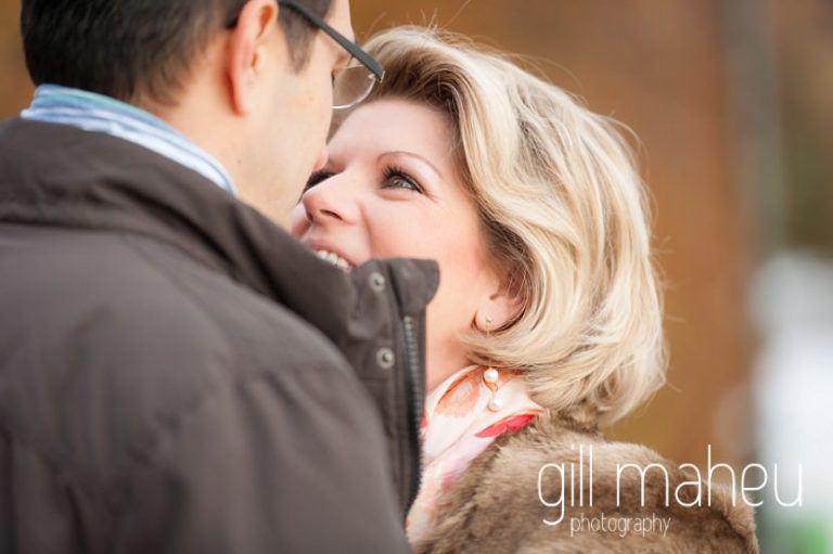 close up of future bride looking at her husband in the winter sunshine in Talloires, Annecy by Gill Maheu Photography, photographe de mariage