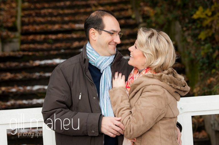engaged couple laughing together in the winter sunshine in Talloires, Annecy by Gill Maheu Photography, photographe de mariage
