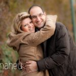 big hug time engaged couple in the winter sunshine in Talloires, Annecy by Gill Maheu Photography, photographe de mariage