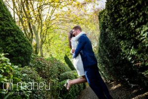 wedding couple embracing in alley of trees after their civil wedding ceremony at Mairie de Versoix, before Hotel La Reserve, Geneve wedding by Gill Maheu Photography, photographe de mariage