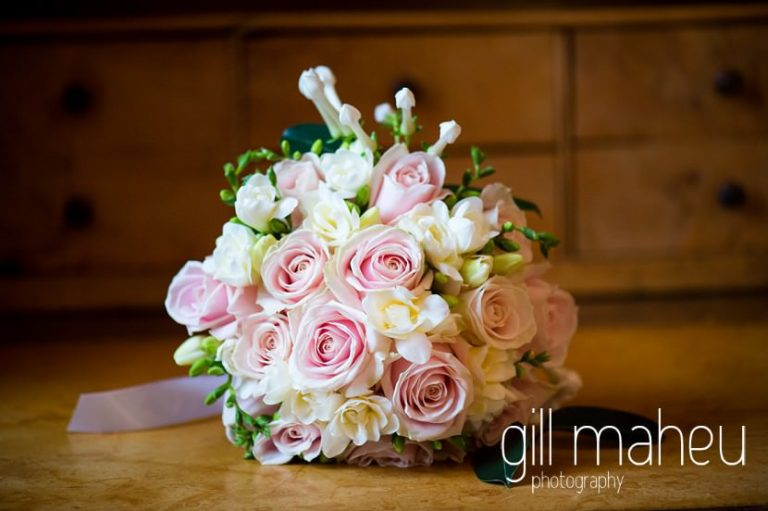 close up details of stunning pink rose and white freesia wedding bouquet at Abbaye de Talloires, Annecy wedding by Gill Maheu Photography, photographe de mariage
