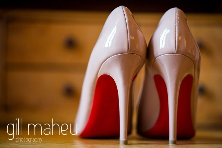 close up details of stunning Christian Louboutin high stiletto shoes at Abbaye de Talloires, Annecy wedding by Gill Maheu Photography, photographe de mariage