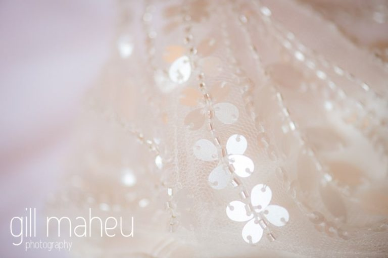 close up details of beautiful sequinned Pronovias wedding dress at Abbaye de Talloires, Annecy wedding by Gill Maheu Photography, photographe de mariage