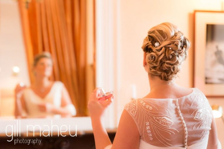 beautiful bride looking in mirror at Abbaye de Talloires, Annecy wedding by Gill Maheu Photography, photographe de mariage